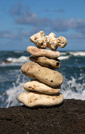 White coral rocks stacked by a meditating zen follower Reklamní fotografie - 4502627