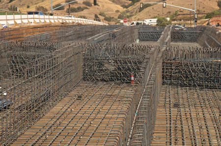 Highway bridge construction project showing rebar and wood framing Stock Photo