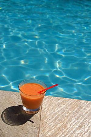 Summer vacation cocktail at a resort swimming pool on Hawaii