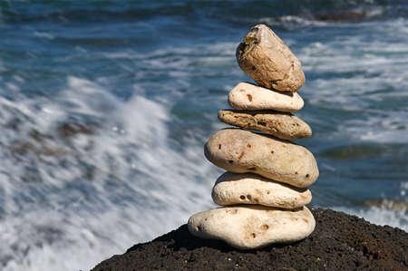 White coral rocks stacked by a meditating zen follower Reklamní fotografie - 4502678