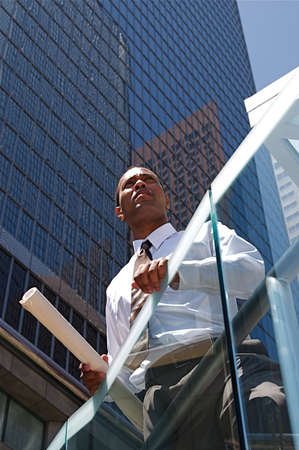 An Arfican-American young urban professional architect surveying the city Stock Photo - 5441842