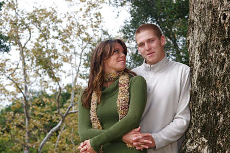 Young couple in an autumn forest picnic area Stock Photo - 5442166