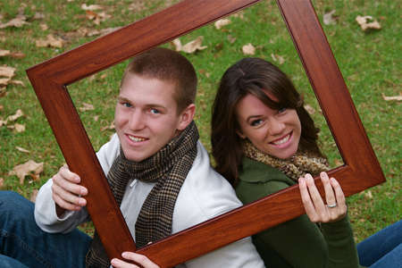 Young couple in an autumn forest picnic area photo