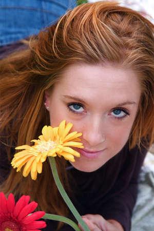 Young beautiful woman in an autumn setting photo
