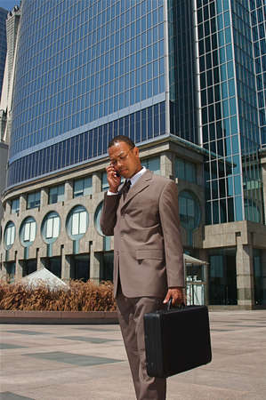 attache: An confident and successful African-American businessman in a power suit