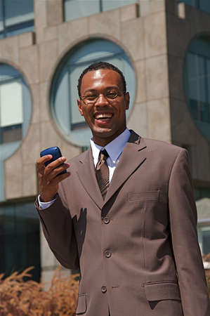 An confident and successful African-American businessman in a power suit photo