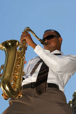 african sax: An youung and trendy African-American sax musician Stock Photo