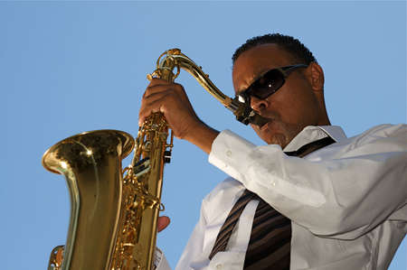 An youung and trendy African-American sax musician photo