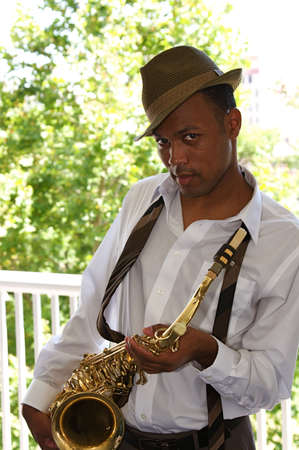 vibe: An youung and trendy African-American sax musician Stock Photo