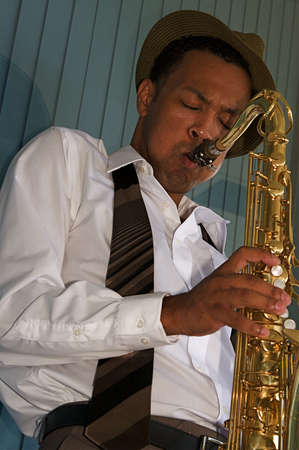 sax: An youung and trendy African-American sax musician Stock Photo