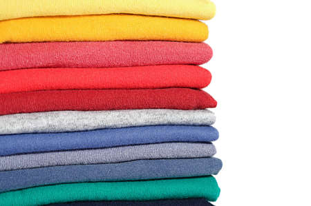 heap: Stack of colored tee shirts on a shelf