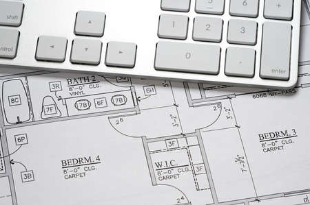 Modern arcbhitect's offic with blueprint and computer keyboard Stock Photo - 5575549