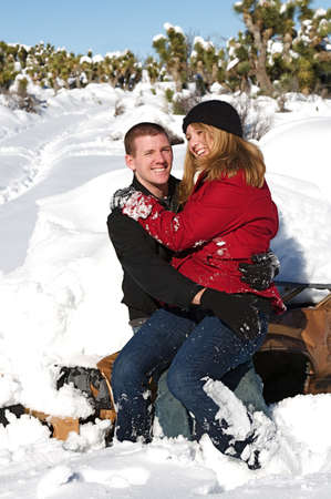 Young people enjoy a fresh snow fall Stock Photo - 5575624