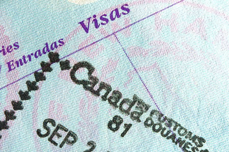visa approved: Passport page with entry stamp for Canada
