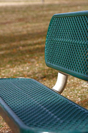 industrial park: Shallow depth of focus on a green play ground bench Stock Photo
