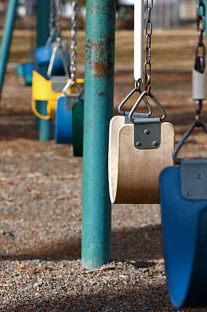 Elements of a swing set at a cold autumn play ground