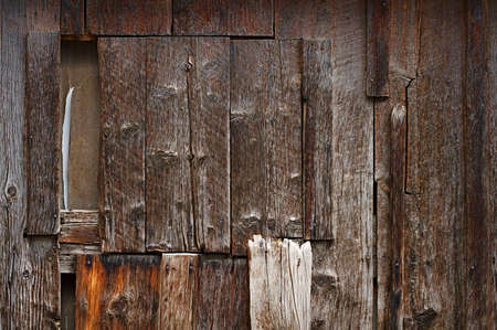 textured wall: The aged and worn side of an old Colorado barn Stock Photo