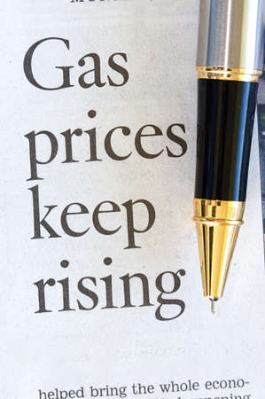 High price for energy and gasoline in a news article headline photo