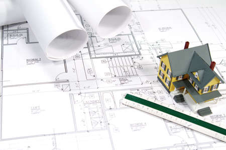 Residential home blueprints with a hand-made house model. Stock Photo - 7331283