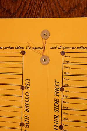 enclosure: Interoffice memo envelope and string enclosure Stock Photo