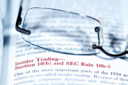 insider trading: Close up view of a business word defition in a dictionary
