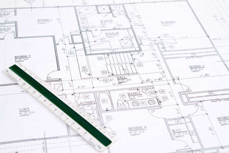 house plan: Residential home blueprints with a hand-made house model.