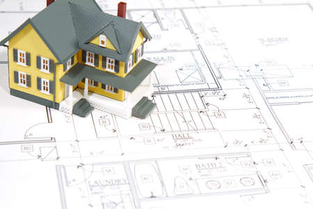 Residential home blueprints with a hand-made house model. Stock Photo - 9049490