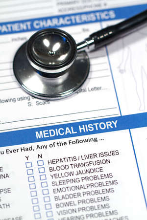 medical history: Close up of a Medical History form and a doctors Stethoscope Stock Photo