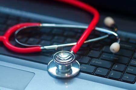 medical lighting: A doctors medical stethoscope in moody dark lighting