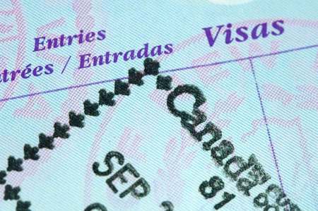 Passport page with entry stamp for Canada Stock Photo - 9162308
