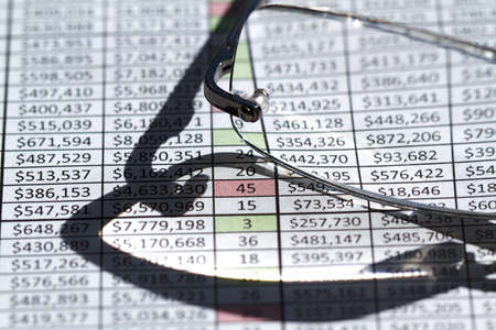 Glasses on an invoice with financial numbers