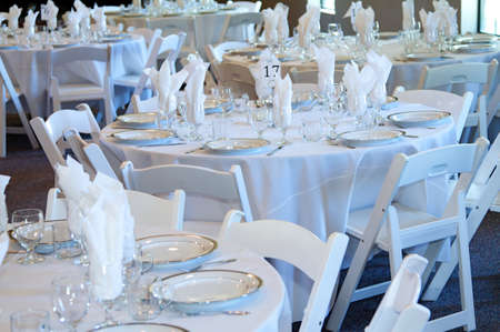 Wedding reception table top with flatware and place settings 版權商用圖片