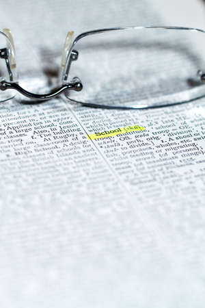 thesaurus: Close up view of a business word defition in a dictionary