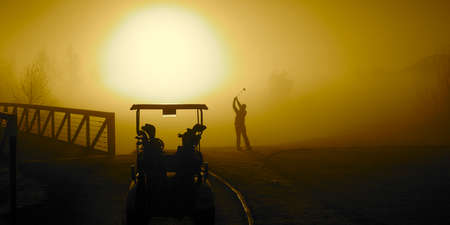 goose club: Golfer in the Golden Sunrise fog on a misty morning with a golf cart Stock Photo