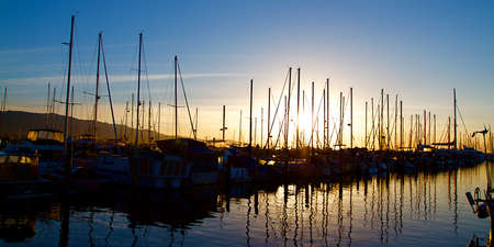 barbara: Santa Barbara Harbor with Yachts Boats at Sunrise in Silhouette Stock Photo