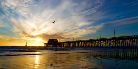orange county: Newport Beach California Pier at Sunset in the Golden Silhouette