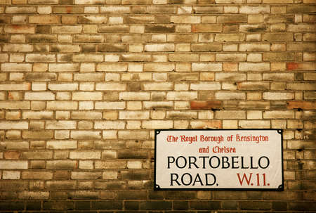 notting: Portobello Road sign on a Brick Facade of a Building Architecture in Notting Hill Chelsea London England Stock Photo