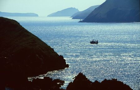 Fishing boat in bay, In the West of Ireland, irish, Dingle Bay photo