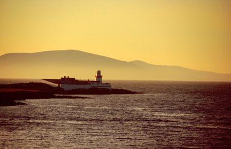 Lighthouse at sunset on Valencia Island, Western Ireland Stock Photo