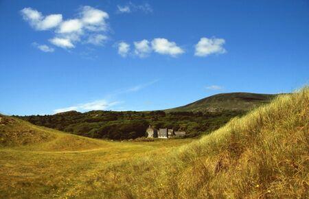 Manor in dunes at the beach near Derryname, Western Ireland photo