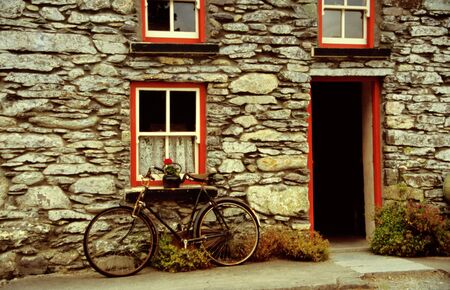 county: Old house with bicycle, bike Stock Photo