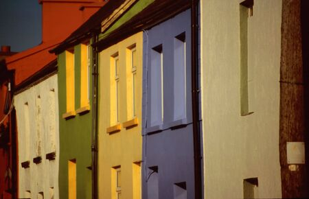 Colourful houses in the harbour of Portmaggee, Western Irland photo