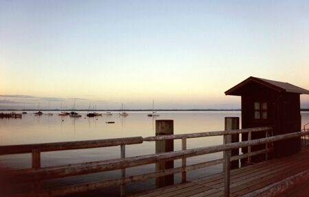 Landing stage at dawn at Lake Chiemsee photo