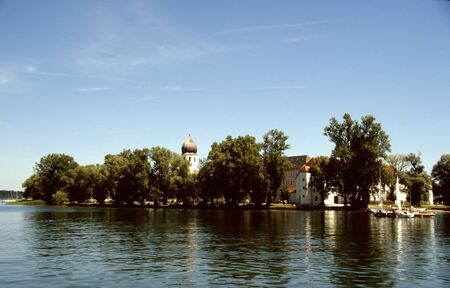 historically: Small island in the summer sunshine in Bavaria, Germany