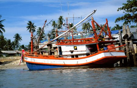 Fishing boat in Thailand in the harbour of Krabi photo