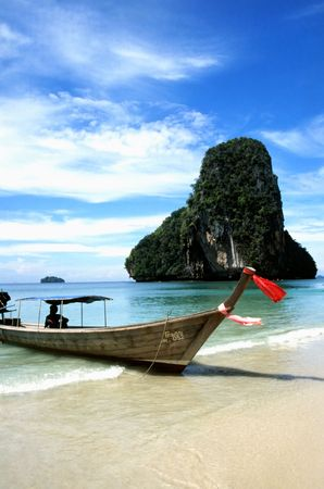Longtail boat on tropical beach near Karbi inthe South of Thailand