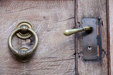 Doorknob and knocker on old wooden door in Idstein in Hesse, Germany photo