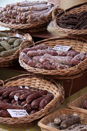 alsace: Sausages in baskets on farmers market in Riquewihr, Alsace, France