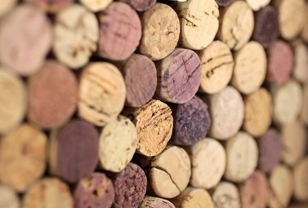 Stacked corks of bottles of red wine photo