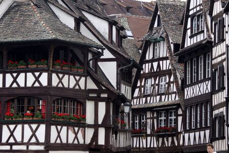 Black and white half-timbered houses in the old town of  Strasbourg, Alsace, France photo
